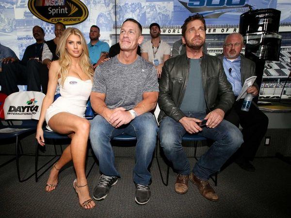 Charlotte McKinney poses with John Cena and Gerard