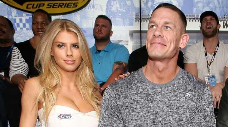 Charlotte McKinney poses with John Cena and Gerard