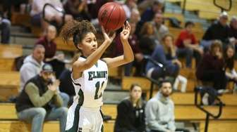 Elmont's Gigi Faison shoots against Garden City during