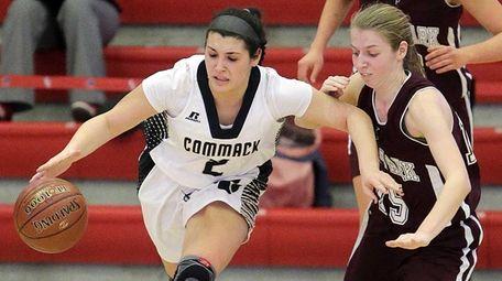 Commack forward Leanne Corso (5) brings the ball