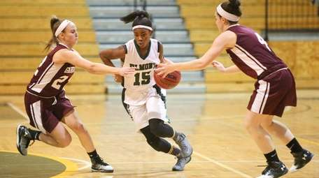 Elmont's Zhaneia Thybulle, center, is defended by