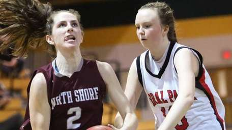 North Shore's Ashleigh Sheerin, left, drives to the
