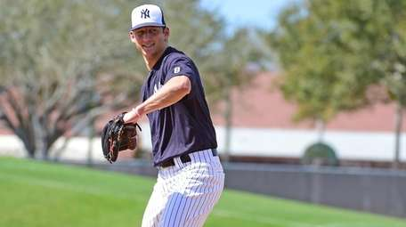 New York Yankees pitcher James Kaprielian works out