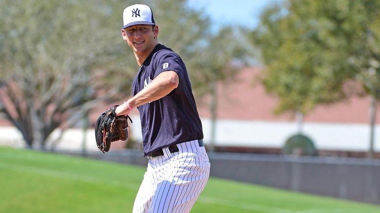 New York Yankees pitcher James Kaprielian works out