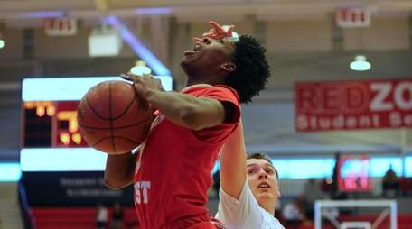 Deven Williams is fouled while attempting a layup