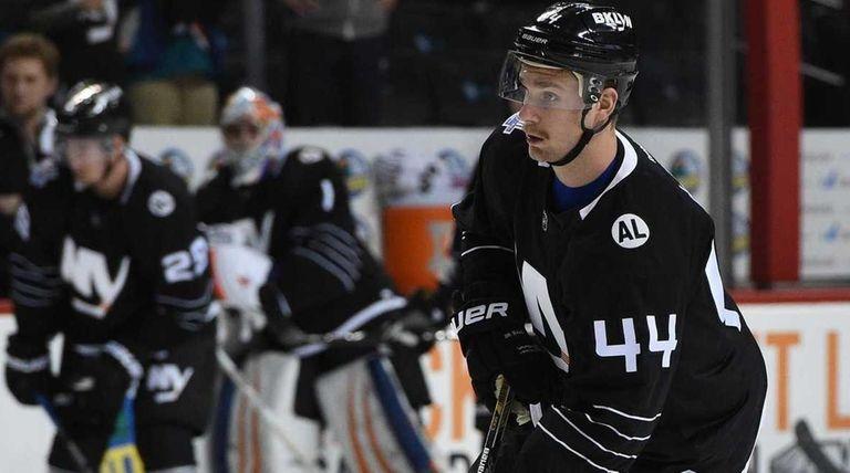 New York Islanders defenseman Calvin de Haan warms