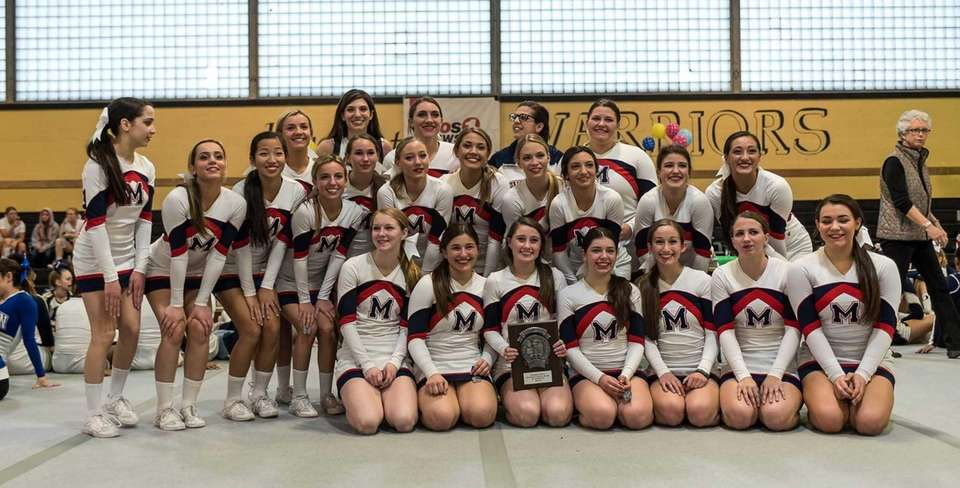 MacArthur poses after the Nassau cheerleading championships at
