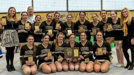 Wantagh poses after winning the Nassau cheerleading championships