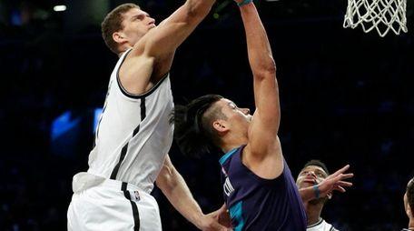 Brooklyn Nets' Brook Lopez blocks a shot