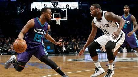 Brooklyn Nets' Donald Sloan defends against Charlotte Hornets'