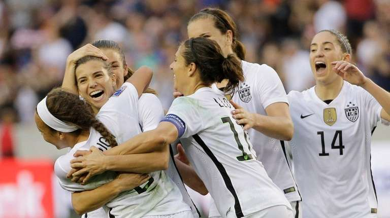 United States Tobin Heath, second from left,