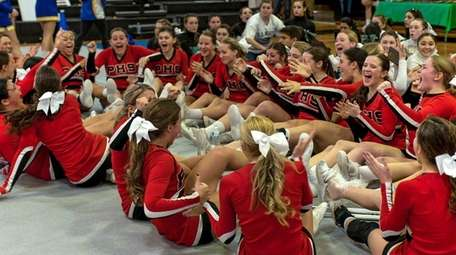 Plainedge celebrates after winning the Nassau Division