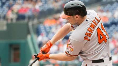 The Baltimore Orioles' Chris Parmelee makes contact