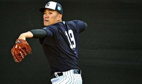 New York Yankees pitcher Masahiro Tanaka throws