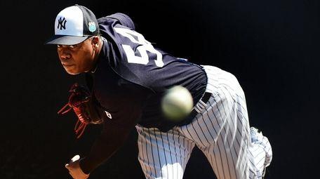 New York Yankees' Aroldis Chapman throws during spring