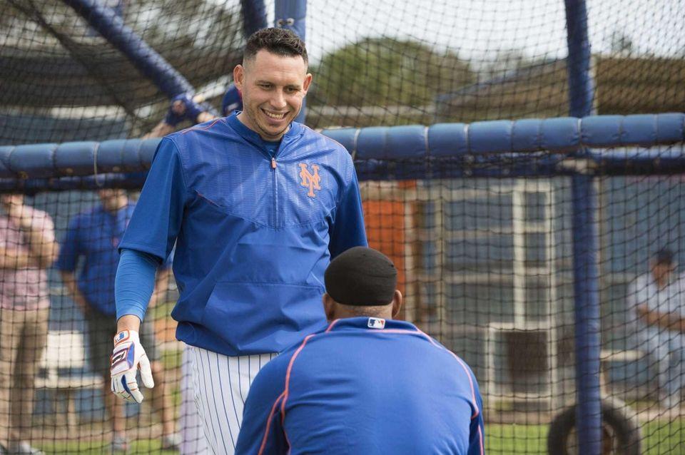 Mets infielder Asdrubal Cabrera talks with Yoenis Cespedes