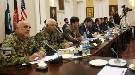Afghan delegates attend a meeting to discuss a