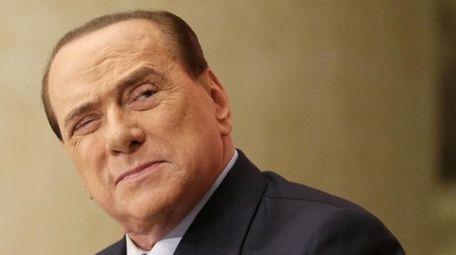Silvio Berlusconi attends a book launch in Rome