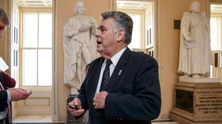 Rep. Peter King, R-N.Y. stands outside the House