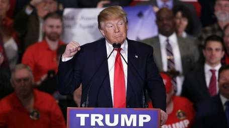 Republican presidential candidate Donald Trump makes a point