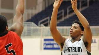 Darius Young of Westbury, right, shoots a jumper