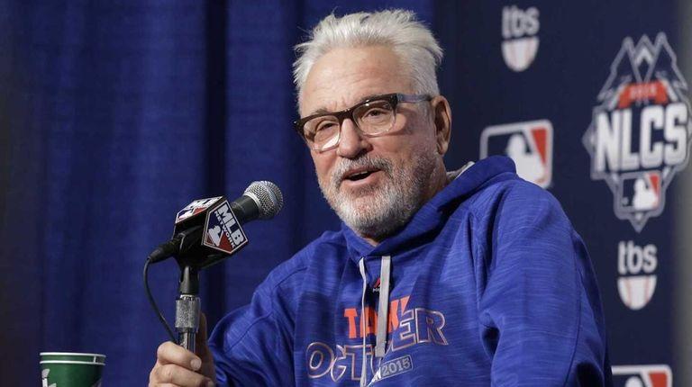 Chicago Cubs manager Joe Maddon talks at a