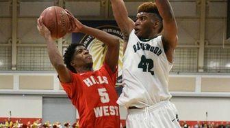 Half Hollow Hills West guard Deven Williams shoots