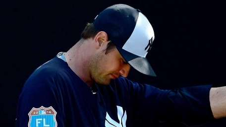 Andrew Miller throws a bullpen session during Yankees