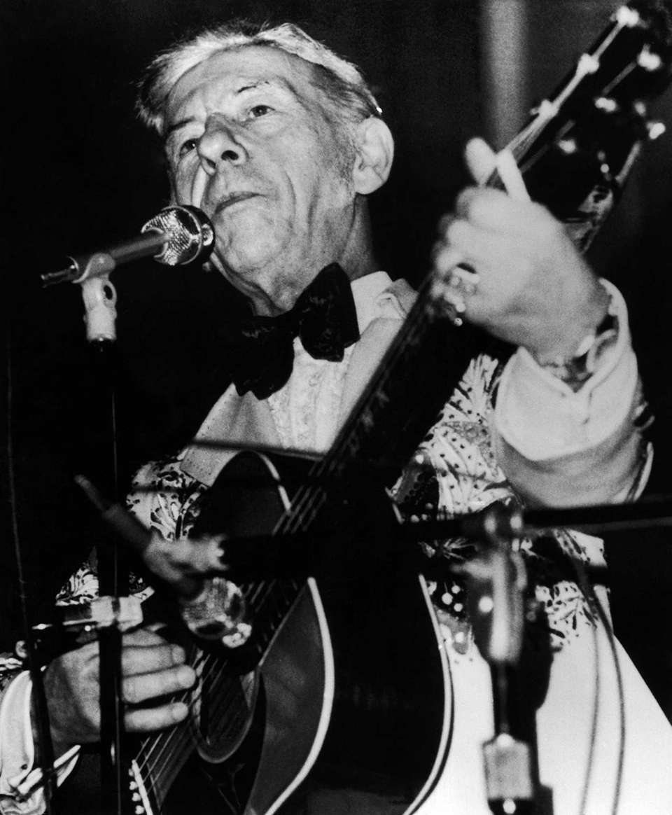 Country music star Hank Snow sings at a