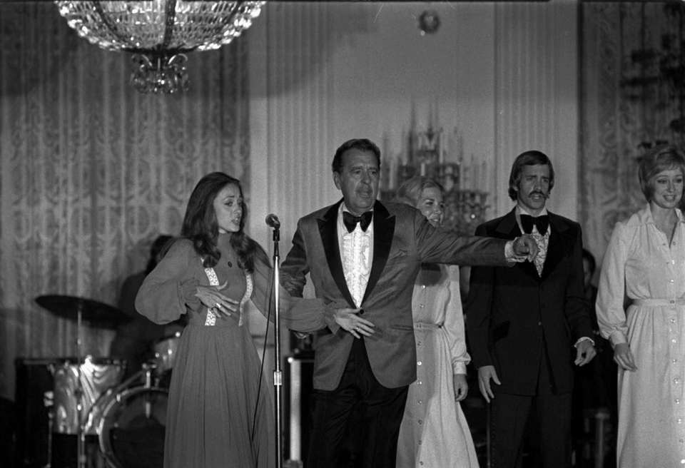 Singer Tennessee Ernie Ford entertaining at the White