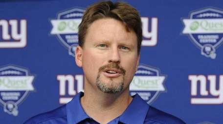 New York Giants' Ben McAdoo answers questions from