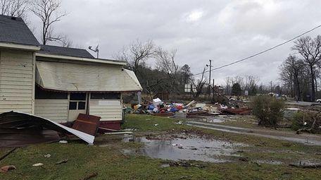 Debris is strewn on a lawn after a