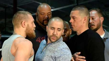 UFC featherweight champion Conor McGregor (L) and