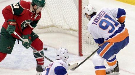 The Islanders' John Tavares scores a power-play goal