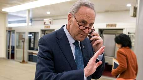Sen. Chuck Schumer, D-N.Y., walks to the Senate