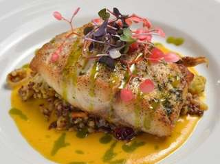 Pan roasted striped bass with red quinoa-and-couscous pilaf