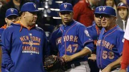 Hansel Robles (47) looks back to the