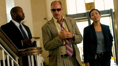 Terence Rosemore, left, Woody Harrelson and Michelle Ang