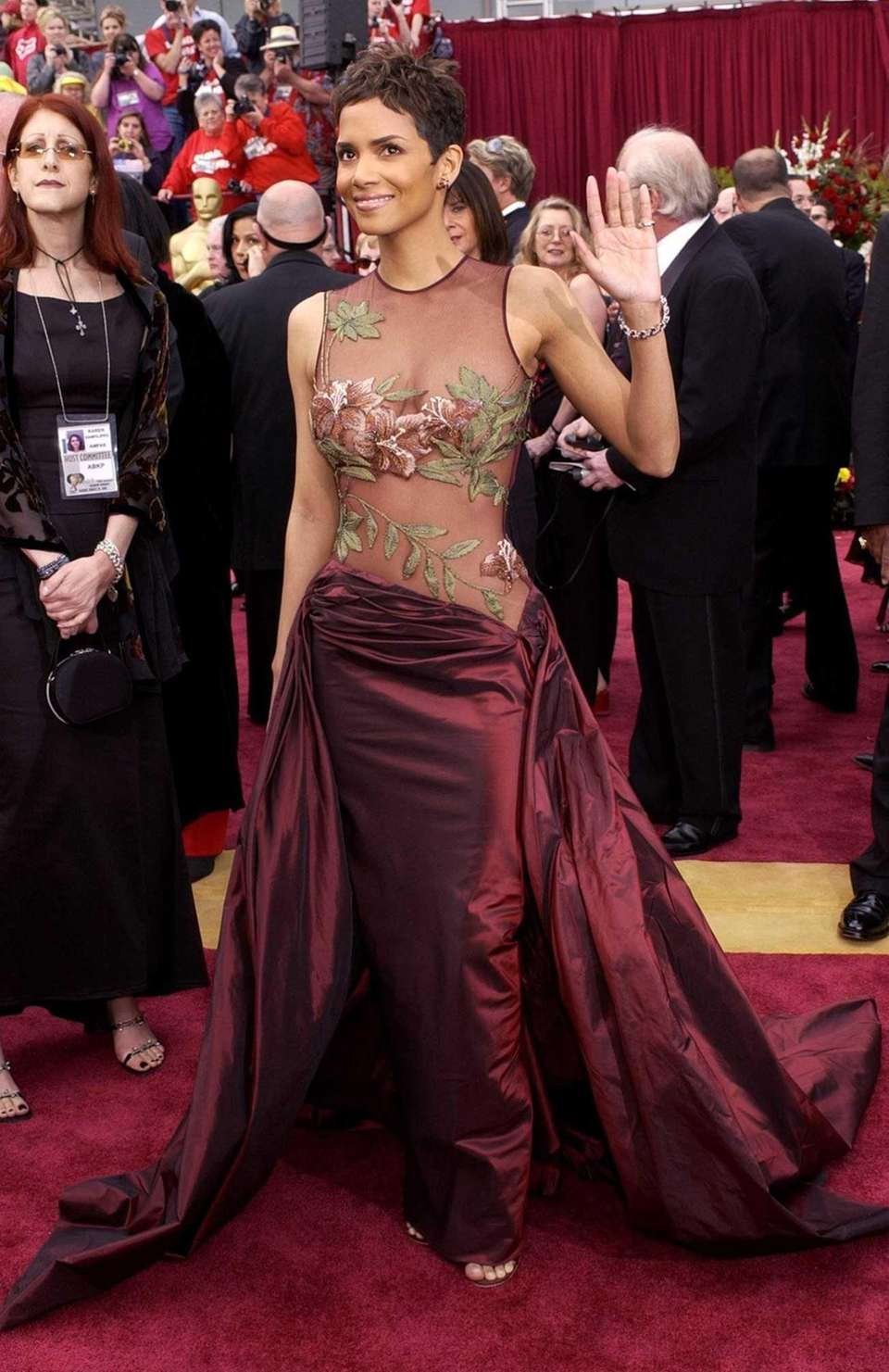 Actress Halle Berry, in Ellie Saab, waves as