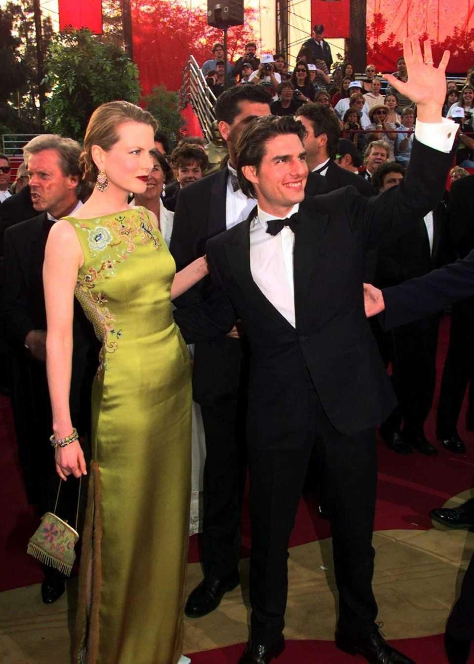 Nicole Kidman, in chartreuse Dior, and then-husband Tom