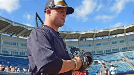 Yankees outfielder Brett Gardner takes the field