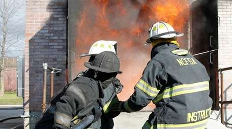Nassau County volunteer firefighters conduct a live residential