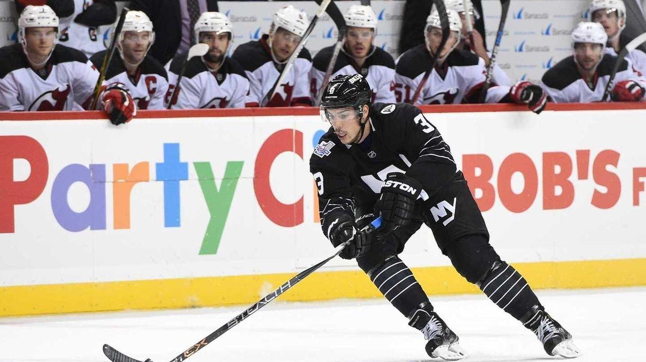 New York Islanders defenseman Travis Hamonic skates
