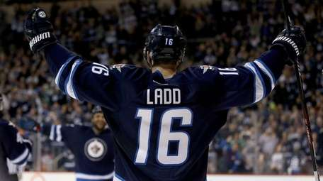 Winnipeg Jets' Andrew Ladd celebrates after scoring