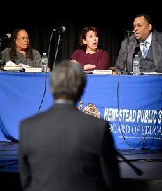 Hempstead school board president LaMont Johnson, right, speaks