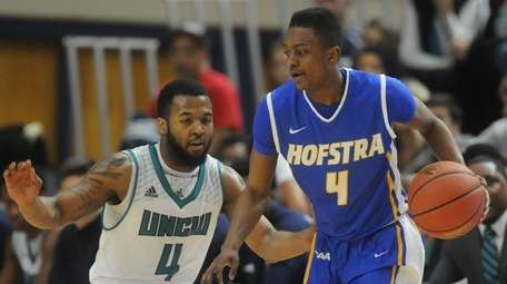 Hofstra's Desure Buie moves the ball around UNCW's