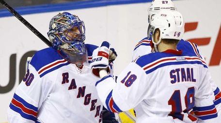 New York Rangers goalie Henrik Lundqvist, left, of