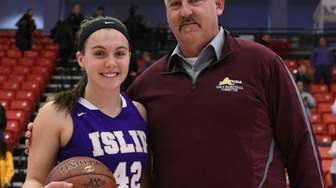Islip's Taryn Ohlmiller receives the game ball from