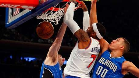 Carmelo Anthony goes into traffic and jams against
