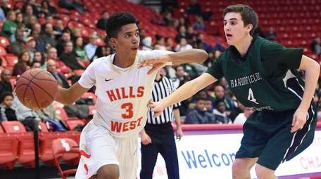 Half Hollow Hills West guard Matthew Asenjo drives